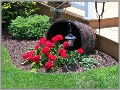 neat idea, nice edging, tipped barrel, with overflowing flowers and solar light.