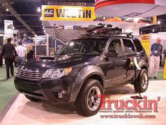 Subaru Forester with some type of awsome offroad kit.