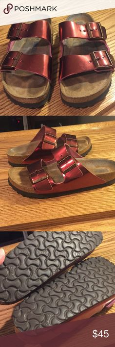 Birkenstock Arizona 37 metallic dark tourmaline Birkenstock Arizona soft footbed narrow size 37 in dark metallic tourmaline red. Very good used condition. No wear to sole and minimal wear to insoles. Very cute color just too big for me. Smoke free, pet loving home. Birkenstock Shoes Sandals
