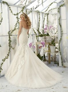 2016 Romantic Mermaid Wedding Dress ♥ Beautiful Alencon Lace on Tulle Mermaid Gown with a Crystal Beaded Sweetheart Neckline, Lace Fitted Bodice Past Hips, Lightly Padded Bust Cups and Boning, Gathered Tulle Mermaid Skirt with Cascading Lace Applique and Scalloped Lace Hem, Scalloped Lace Edged Tulle Chapel Train, Crystal Beaded Back. #dreamwedding #bridalgown #customweddingdress #straplessweddingdress #crystal #sweetheart #laceweddingdress #mermaidweddingdress #sayyestothedress #sexy