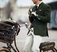 A stylish man rides a bike from the Hotel Savoy in Florence