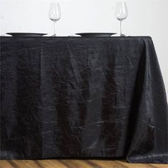 """Black 90x156"""" Crinkle Taffeta Tablecloth /  Let this exquisite tablecloth enchant the entire ambiance of your special event with its seamless luster and upscale look. Blending the modern flair with traditional sophistication, this magnum opus is simply magnificent. Spread it atop your dreary tables or plain, lackluster table covers to achieve the excellence of class and vibrancy. The lovely crinkles accented all over the surface coupled with the impeccable metallic glint of lustrous taffeta…"""