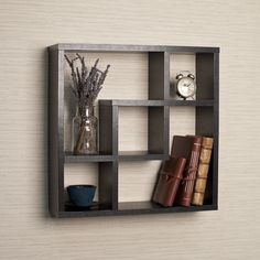 Decorative wall shelf in geometric pattern with 5 openings in different configurations is clean and minimalistic in look and will frame your decorative items and collectibles.  Made of laminated MDF, it attaches to the wall with no visible hardware.  %0D