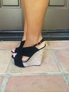 These wedges feature soft suede like upper material and a textural embroidery platform, an open toe and a buckle closure at the ankle.