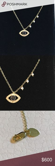"""14K gold evil eye necklace. MeiraT 14K gold evil eye necklace. Evil eye is in blue sapphire with surrounding diamonds. Eye is approximately 1/2"""" wide. 3 small freshwater pearls on one side.  Has 3 """"O"""" rings so it can be adjusted to 16"""" 17"""" or 18"""". Clasp is stamped with 14K gold (pictured) and has MeiraT tag next to it. Excellent condition. MeiraT Jewelry Necklaces"""