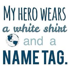 My hero wears a white shirt and a name tag