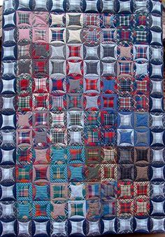 Quilt from men's shirts (plaids), a reclaimed clothing quilt by Hanne Hector Schroeder (Denmark).  Faux cathedral windows design.