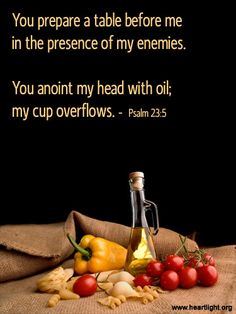 Inspirational illustration of Psalm 23:5 -- You prepare a table before me in the presence of my enemies. You anoint my head with oil; my cup overflows.