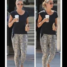 EVLEO SNAKE PANT AS SEEN ON HEIDI KLUM If Heidi Klum can rock these - so can you! The leggings were designed not only to be stylish but comfortable. The Evleo Baggy Snake Pant features a relaxed fit with side pockets. Mustard snake print featured throughout. Wide elastic waistband. Made out of 95% Polyester and 5% Spandex, these leggings are designed to be breathable, stretchy and stylish. Baggy in the hips and thighs and tapered through the ankle, these leggings are perfection! Like new…
