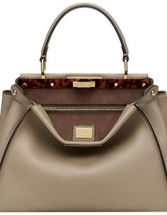 The Fendi Peekaboo Iconic Medium Dove Grey Calfskin Leather Tote is a top 10 member favorite on Tradesy. Fendi Peekaboo Bag, Dove Grey, Hermes Kelly, Shoulder Strap, Handbags, Medium, Leather, Accessories, Shoes