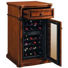 Keep your favorite vintages fresh with this essential wine cabinet. Showcasing a top accessory drawer and bottom thermoelectric wine cooler, this innovative design keeps up to 18 bottles chilled and preserved with dual temperature zones.     Product: Wine cabinet   Construction Material: High quality cherry and ash, walnut veneers and poplar solids   Color: Pecan cherry   Features:  18 bottle dual zone thermoelectric wine cooler  Upper zone holds six bottles at 45 to 54 degrees  Lower z…