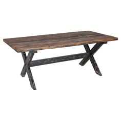 Handcrafted reclaimed boat wood dining table with a distressed finished and crisscross legs.  Product: Dining tableConstr...