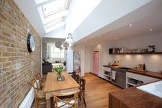 narrow victorian house side extension. Love how they brought light into the room with the ceiling. Really helps open the area up.