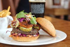 Angus Burger: Angus Beef, BBQ Pulled Pork, Cole Slaw, Pickles, Sesame Challah Bun. Available at Hubbell & Hudson Kitchen.