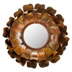Iron wall mirror with a blossoming silhouette.Product: Wall mirrorConstruction Material: Iron and mirrored glassColor: CopperFeatures: Made in IndiaWill enhance any spaceDimensions: 19.3 Diameter