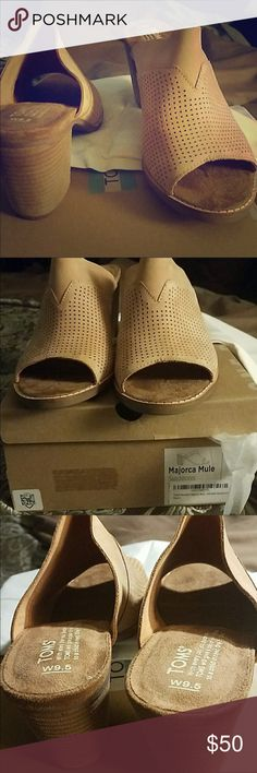 NWOB Toms leather Mules Brand new, never worn. Unfortunately I misplaced the box shortly after these photos. I will look around but as for now they are being sold as brand new without box. They are gorgeous and such a neutral color! Real leather, tan, size 9.5 Toms Shoes Mules & Clogs