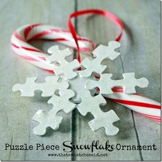 Puzzle Piece Snowflake Ornament. This could be simplified for kids to do with just paint and glitter and not worry about Modge podge