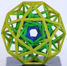 George W. Hart - Back to a geometric vein, I like the spiral way in which these three nested icosidodecahedra connect.