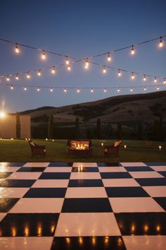 Dreamy Checkerboard Dance Floor Setting for the Wedding Reception + Party! With a Firepit off to one side and dreamy cafe lighting strands - Perfect backdrop for some wonderful memories! Stephanie Williams Photography