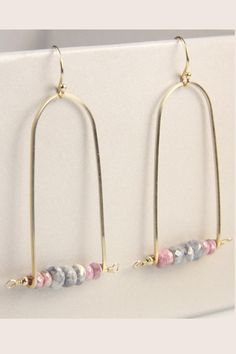 "Simple and clean simplistic design with Pink Sapphire and Gray Labradorite Beads. The delicate frames are created with 14k Gold Fill wire. The ear wires are also 14k Gold Fill perfect for those with sensitivity. Please expect natural variation in these stones and in each pair of handmade earrings.  Earrings Measure 2"" L x 3/4"" W Handmade in our studio in Brooklyn NY Labradorite Sapphire Earrings by Fanaberie. Accessories - Jewelry - Earrings - Statement Williamsburg Brooklyn New York City"