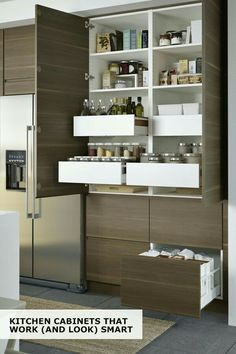 Pantry space is a must in kitchens, no matter how big or small. I especially like this one due to the vertical height and the mix of drawers and shelves.