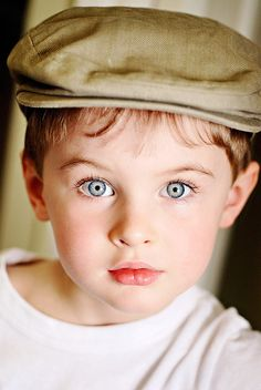 Bright eyed and a newsboy cap with a white T! :) those eyelashes aren't hurting the pic either! ;)