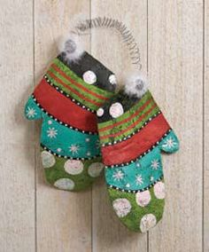 "Pair of Mittens Door Decoration. Free Ground Shipping (continental US only). Here is a unusual door decoration - a pair of Mittens. Ours are colorful and decorated with dots, stars and a bit of marabou. They are connected by a spring so they stay together. Made of Aluminum Screen. Approximately 15"" Tall. $32.99.  http://www.happyholidayware.com/Christmas-Lawn-Door-Outdoor-Decorations.htm"