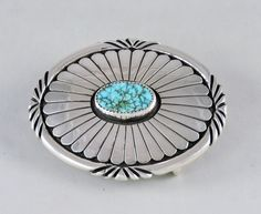 Modern Navajo Indian concha style belt buckle with a natural Kingman turquoise in a shdow box setting.