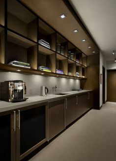 Puck lights under these bookshelves create pools of light and dark for drama and task lighting. Pucks tend to produce areas of brightness and darkness, whereas LED tape and strips provide an even distribution of light.