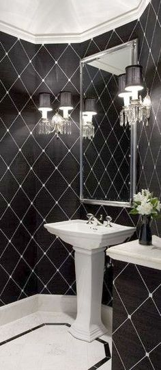Holy glam! Here is another example of how a graphic black white color scheme can visually enlarge a space.