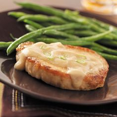 Slow Cooker Pork Chops Recipe -Everyone will enjoy these fork-tender pork chops with a creamy, light gravy. Serve with a green vegetable, mashed potatoes and coleslaw or a salad. —Sue Bingham, Madisonville, Tennessee