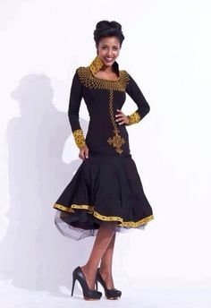 "Modern habesha dress made with black velvet material traditionally only used to make caba- but we love the embroidery ""tlefe"" and the style #HageresebFashionista #Habesah #Ethiopia #Eritrea"