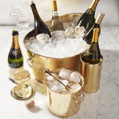 The warmth and richness of gold is unmatched, and this ice bucket brings the precious metal's brilliant charm to entertaining. The ice bucket has a plated-gold finish detailed with a hand-hammered trim for an elegant touch. Wine Chiller Bucket, Wine Bucket, Wine Chillers, Bucket Cooler, Wine Carafe, Wine Display, Wine Decor, Wine Party Decorations, Cheap Wine