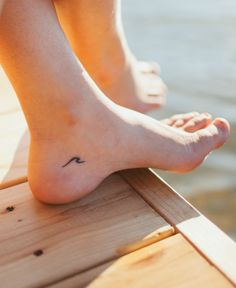 Wave tattoo on ankle