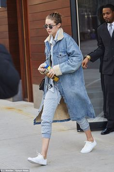 Quirky: The American beauty wrapped up in a wool-lined knee-length denim jacket which she wore over a lighter top adorned with dinosaurs