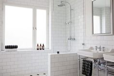 wall mounted shower valve (instead of inside the wall), glass room divider, white subway tiles.  even with a window in the shower.