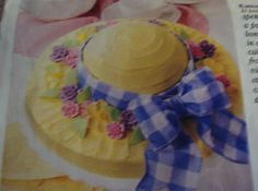 "This looks like it takes hours to make! But this ""Bonnet Cake"" is done in a flash!...Thanks to cake mix, prepared frosting and candy violets,daises and other flowers you can buy at your grocery store.I found this recipe  and picture in the 1998 Family Circle magazine. It was featured on the cover.Thank you Family Circle.It so beautiful and easy!!A joy to behold!My Easter recipe # 5"