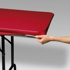 Classic Red Stay Put Plastic Rectangular Tablecovers. Case of 12 table covers. Each table cover is 30 inches X 96 inches long! Each table cover has elastic to hold your table cover in place!