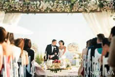 An elegant wedding at Terranea Resort filled with tradition and decorated with an abundance of food and florals and soft blush lighting. Photo by Lin & Jirsa. Lighting by Elevated Pulse. #weddinginspiration #ballroomwedding #weddinglighting #blushwedding #persianwedding #weddingideas #brides #receptiondecor #weddingceremony #sofreh