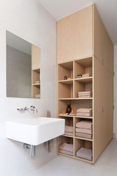 Custom bathroom storage to organize towels, toiletries, more.  Made by Cohen in collaboration with Robson Rak Architects – Armadale