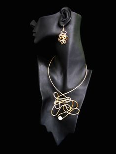 Raw. Wild. Ann Hepler's designs are free-form and fun, always contemporary. Stones and beads wrapped in precious gold or other fine wires.