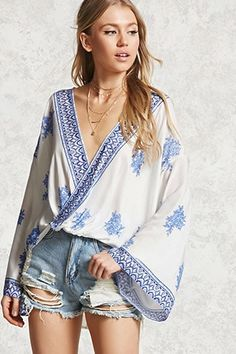 A woven top featuring a floral print, abstract trim along the surplice neckline, dropped shoulders, long kimono-style sleeves, and a curved back hem. Hawaiin Outfit Ideas, Long Kimono, Kimono Top, Kimono Style, Floral Kimono, Forever 21 Fashion, Crochet Blouse, Kimono Fashion, Stylish Girl