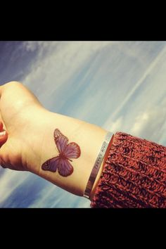 Purple butterfly wrist tattoo