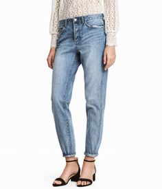 Denim blue. 5-pocket, low-rise jeans in washed denim with heavily distressed details, button fly, and slightly wider, tapered legs.