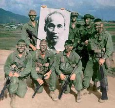 """This photo was taken at Camp Reasoner in Da Nang in November 1968. It is the 3rd Platoon, 1st Force Recon Co., Team call sign, """"Moose Peak"""". Kneeling front left to right: Cpl. Sammy Carver, Lcpl. John Carr. Pfc John Wells. Standing rear left to right: Lcpl. Terry Campbell, Ho Chi Minh, Lcpl. Robert Regan, Cpl. John Mcdonugh, Sgt. Robert Buda. The photo was obtained on patrol on Charlie Ridge when the team over ran an NVA antiaircraft gun position. ~ Vietnam War"""