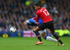 Ross Barkley and Chris Smalling tussle for the ball.