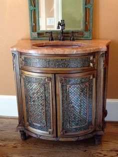 Gorgeous mosaic tile on cabinet