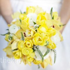 one of the prettiest yellow bouquets ive seen so far.  dont like the green crap though.