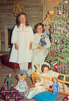 Little girls with their dolls Christmas snapshot, 1964~~OMGSH..there's an original GI JOE boy doll in dk green on the left just like the one my brother had;) And that's a teen doll, Tammy in blue on the right~my younger sister had one...I love memories
