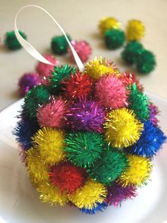 We can't get enough of pom poms at Christmas time! #HoliDIY http://www.ivillage.com/diy-ornaments-kids/6-a-551304